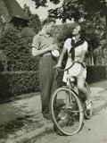 Young Couple Talking on Street  Woman on Bicycle