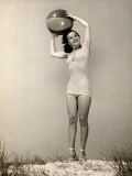 Woman Holding Beach Ball Over Her Head
