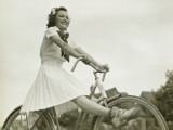 Young Woman Riding on Bicycle With Outstretched Legs