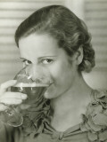 Young Woman Drinking Glass of Beer  Portrait