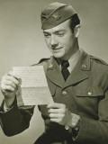 World War II Army Solider Reading Letter in Studio  Portrait