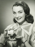 Woman Pouring Pills From Bottle Into Hand in Studio  Portrait
