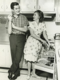 Young Couple Standing in Kitchen  Woman at Dishwasher
