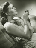 Elegant Woman Sitting on Couch  Smoking Cigarette