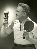 Man With Glass of Beer and Ping-Pong Paddle