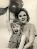 Smiling Mother and Daughter With Balloons