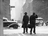 Two Men Walking on City Street in Snow-Storm