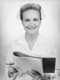 Nurse Holding Medical Chart in Studio  Portrait