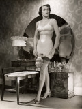 Woman in Brassiere and Girdle at Her Mirror