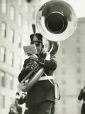Young Soldier in Old-Styled Uniform Playing on Tuba