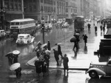 Traffic and People on Rainy City Street