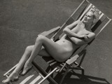 Nude Woman Sunbathing in Beach Chair