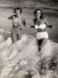 Women Playing in the Surf at the Beach