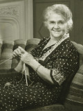 Senior Woman Knitting in Living Room  Portrait