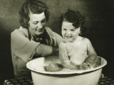 Mother Bathing Daughter (12-18 Months) in Basin