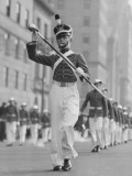 Drum Major Leading Parade in Old-Fashioned Uniforms