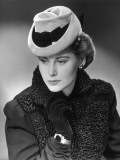 Portrait of Sophisticated Woman With Fancy Hat