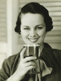 Young Woman Holding Glass of Beer  Portrait