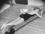 Young Woman Sun Tanning on Cruiser Deck
