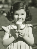 Girl Holding Ice Cream  Posing Outdoors