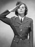 Woman in Military Uniform Saluting