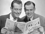 Two Businessmen Reading Newspaper