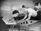 Female Workers Working on Plane