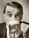 Man Drinking Mug of Beer