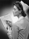 Nurse Reading Patient&#39;s Chart