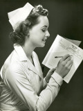 Nurse With Patient's Medical Chart