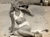 Woman in Swimsuit Having a Soda