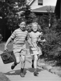 Boy and Girl Running With Books