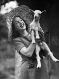 Woman Laughing and Holding a Goat