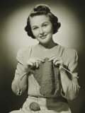 Young Woman Knitting in Studio  Portrait