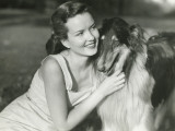 Young Woman Hugging Collie in Park