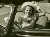 Woman at Wheel of Convertible