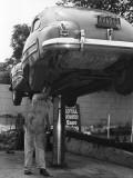 Mechanic Working on Underside of Car