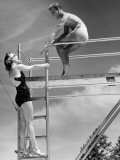 Couple in Bathing Suits on Diving Board