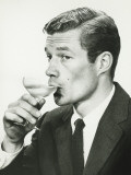 Young Man in Suit  Drinking Wine