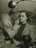 Optician Examining Woman's Eye