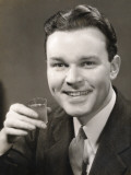 Man Holding Up Drink
