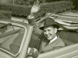 Man Waving From Car