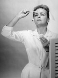 Nurse Reading Thermometer