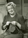Smiling Woman Knitting
