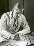 Doctor Writes at His Desk