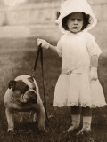 Girl in Dress and Hat  Holding Bulldog on Lead