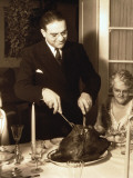 Father Carving Turkey at Table on Christmas Day