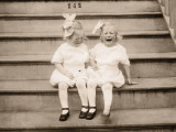 Twin Girls Sitting on Front Steps of House  Crying