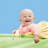 Smiling Baby in a Baby Carriage