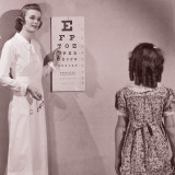 Healthcare Worker Giving Girl (8-10) Eye Examination